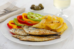 Fried sardines with potato Royalty Free Stock Images