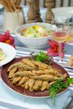 Fried sardines with potato salad Royalty Free Stock Images