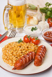 Fried sausage and beans Royalty Free Stock Photos
