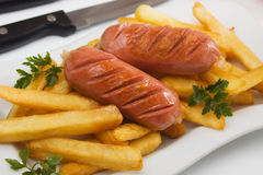 Fried sausage with french fries Royalty Free Stock Photos