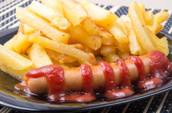 Fried sausage and french fries Royalty Free Stock Images