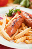 Fried sausage with french fries Stock Image