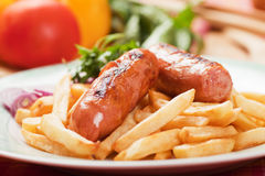 Fried sausage with french fries Stock Images