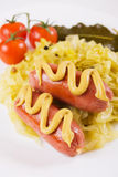 Fried sausage with mustard and sauerkraut Stock Photo