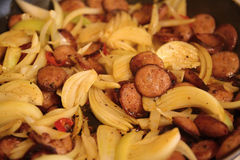 Fried sausage with onion Stock Photography