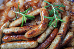 Fried sausage and onions Stock Image