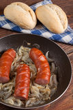 Fried sausage with onions. Royalty Free Stock Photos
