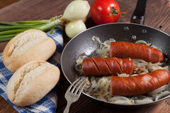 Fried sausage with onions. Stock Photography