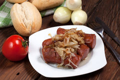 Fried sausage with onions. Royalty Free Stock Photography