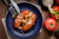 Fried sausage with onions. Royalty Free Stock Photo