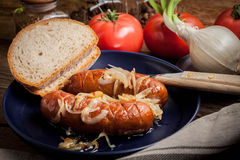 Fried sausage with onions. Stock Photos