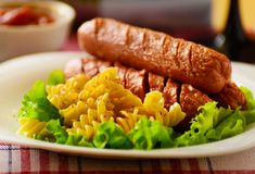 Fried sausage with pasta. Royalty Free Stock Images