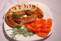 Fried sausage on a plate Royalty Free Stock Photo