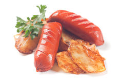 Fried sausage with potato chips Royalty Free Stock Images