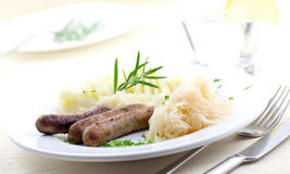 Fried sausage sauerkraut Royalty Free Stock Image