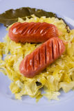 Fried sausage and sauerkraut Stock Photo