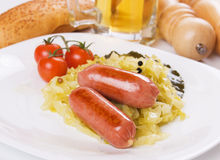 Fried sausage and sauerkraut Stock Photography