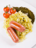 Fried sausage and sauerkraut Royalty Free Stock Image