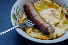 Fried sausage and scrambled eggs Royalty Free Stock Photography
