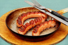 Fried sausage in a skillet. Royalty Free Stock Photo