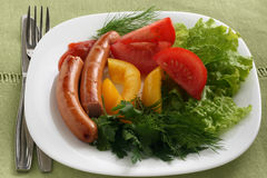 Fried sausage with vegetables Royalty Free Stock Photos