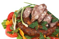 Fried sausage with vegetables Royalty Free Stock Photo