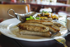 Fried sausages. Royalty Free Stock Images
