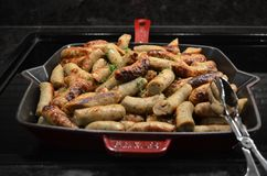 Sausages In Cast Iron Skillet. Fried sausages in cast iron skillet stock photo