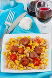 Fried sausages with corn and beans on the plate Royalty Free Stock Images