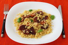 Fried sausages with couscous Royalty Free Stock Photos