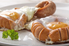 Fried sausages and eggs Royalty Free Stock Image
