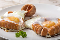 Fried sausages and eggs Royalty Free Stock Images