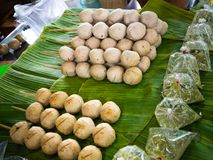 Fried sausages and fried meatballs from pork. on banana leaf ready for sale in the fresh markets, Thailand street food. Royalty Free Stock Photo