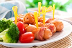 Fried sausages. And vegetables with sauce Royalty Free Stock Photo