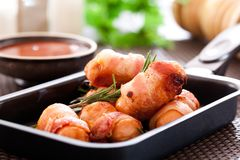 Fried sausages. And vegetables with sauce Stock Photo
