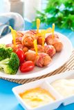 Fried sausages. And vegetables with sauce Royalty Free Stock Images
