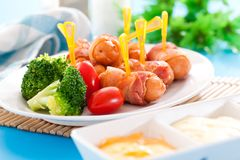 Fried sausages. And vegetables with sauce Stock Image
