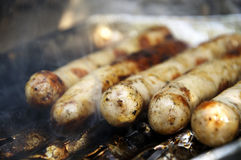 Fried Sausages on the grill Royalty Free Stock Image