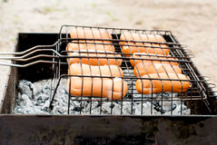 Fried sausages on the grill Stock Photo