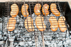 Fried sausages on the grill Stock Images