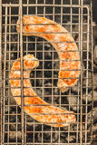 Fried sausages in the grill to cook in the grill Stock Photo