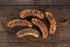 Fried sausages Stock Images