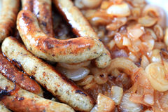 Fried sausages and onion Royalty Free Stock Image