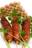 Fried sausages with parsley. Fried sausages on white dish with parsley Royalty Free Stock Images