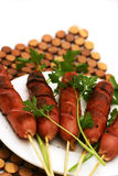 Fried sausages with parsley on dish. Fried sausages on white dish with parsley Stock Photo