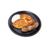 Fried sausages and potato-fried pancakes. Fried sausages and potato-fried pancakes with stuffing Royalty Free Stock Photos