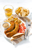 Fried sausages with potatoes, mustard and beer Royalty Free Stock Photo