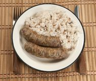 Fried sausages and rice Stock Image
