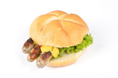 Fried sausages in a roll Royalty Free Stock Images