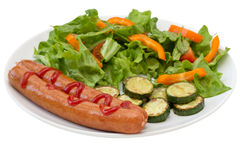 Fried sausages with salad. And vegetables Stock Photos